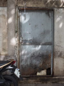 when to replace a damaged industrial door